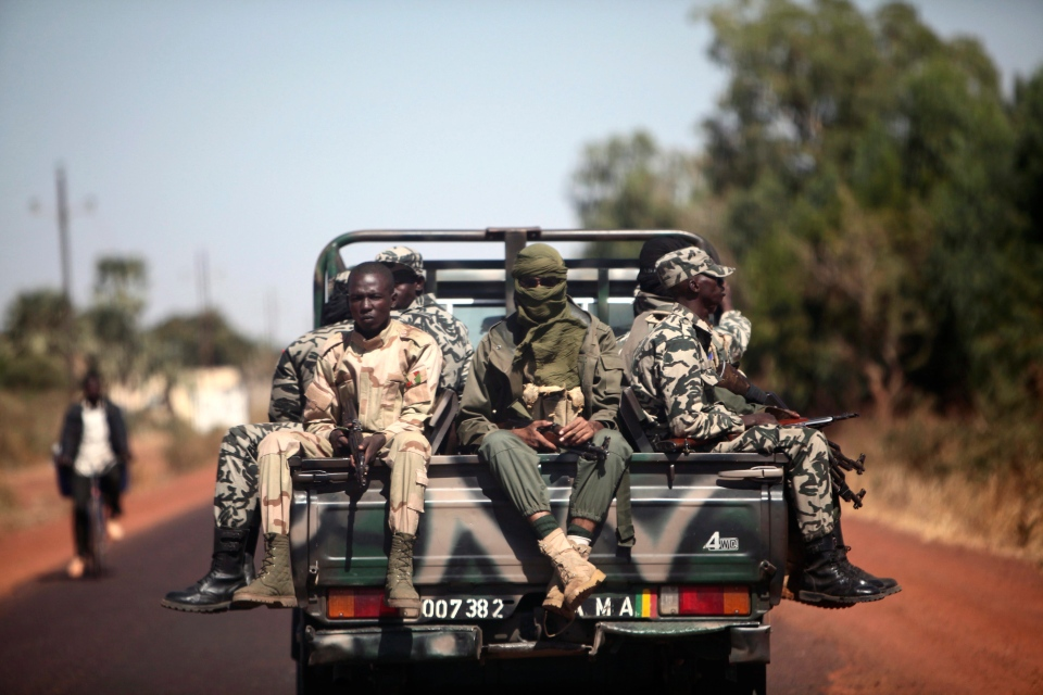 Malian soldiers are seen on their way to Markala, Mali, some 240 kms north of Bamako on Friday, Jan. 18, 2013. (AP / Thibault Camus)
