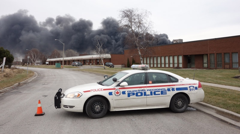 A Durham police cruiser is seen in front of a fire in Oshawa, Ont., Jan. 19, 2013. (CTV Toronto /  Tom Podolec)
