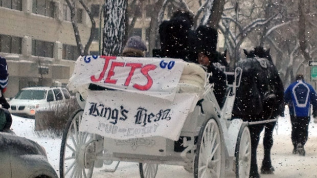 Many fans are excited about the event, despite heavy blowing snow in the downtown area.