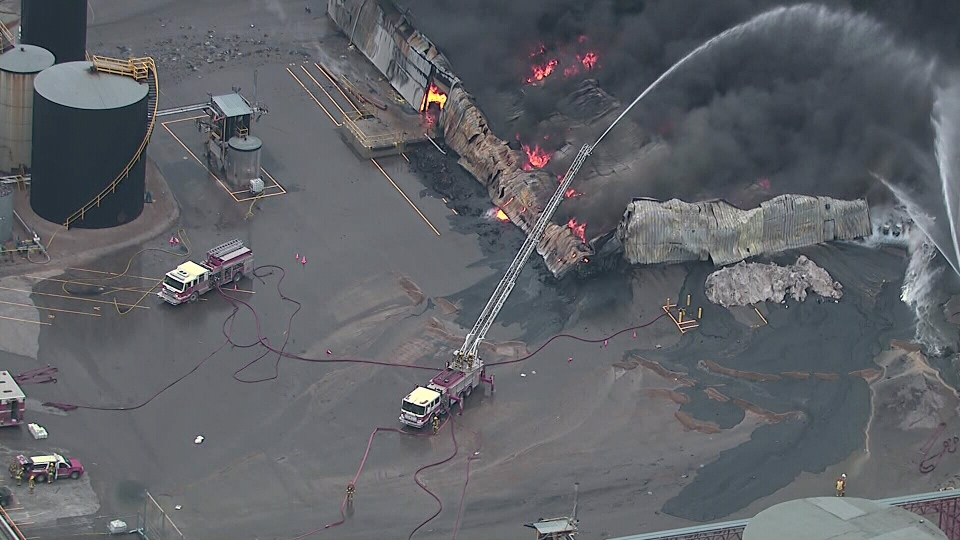 Firefighters battle a massive blaze at an industrial plant in Oshawa, Ont. on Saturday, Jan. 19, 2013.