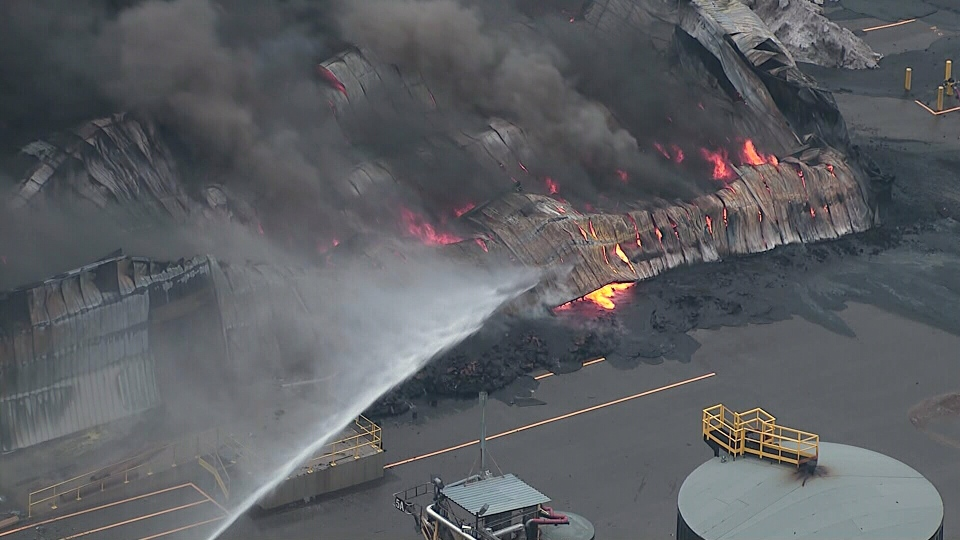 A number of nearby businesses have been evacuated as crews battle a massive fire at an industrial plant in Oshawa, Ont. on Saturday, Jan. 19, 2013.
