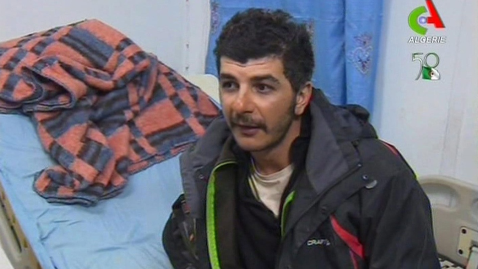 An unidentified rescued hostage speaks to the media in a hospital in Ain Amenas, Algeria, in this image taken from television Friday Jan. 18, 2013. (AP / Canal Algerie via Associated Press TV)