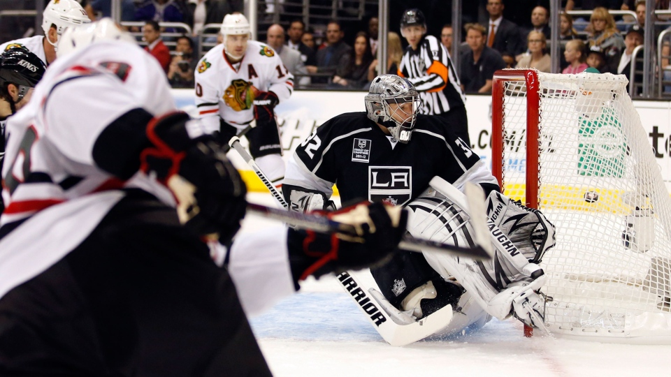 Chicago Blackhawks' Patrick Kane, foreground left, scores against Los Angeles Kings goalie Jonathan Quick during the first period of an NHL hockey game in Los Angeles, Saturday, Jan. 19, 2013. (AP / Jae C. Hong)