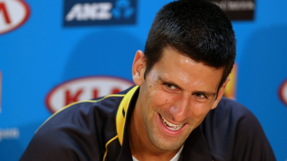 Defending men's singles champion Serbia's Novak Djokovic smiles during a press conference ahead of the Australian Open tennis championship in Melbourne, Australia, Saturday, Jan. 12, 2013. (AP / Greg Baker)
