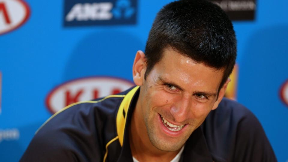 Defending men's singles champion Serbia's Novak Djokovic smiles during a press conference ahead of the Australian Open tennis championship in Melbourne, Australia, Saturday, Jan. 12, 2013. (AP / Greg Baker)