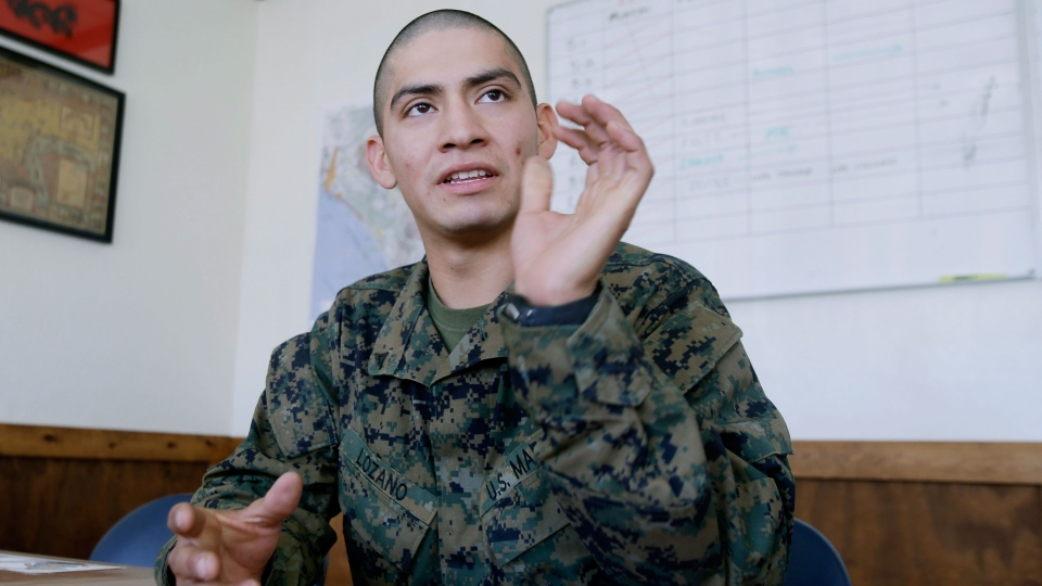 U.S. Marine Lance Corporal Carlos Lazano talks about a special training he underwent in which Marines were taught methods to 'quiet the mind' and to reach an inner calm as a means to battle stress at Camp Pendlton, Calif. on Tuesday Jan. 15, 2013. (AP / Lenny Ignelzi)