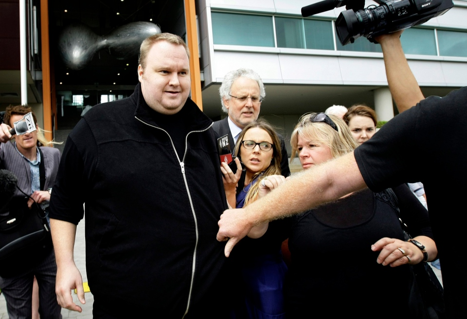 Kim Dotcom, the founder of the file-sharing website Megaupload, walks past media after he was granted bail and released on Wednesday, Feb. 22, 2012, in Auckland, New Zealand. (AP, New Zealand Herald / Sarah Ivey)