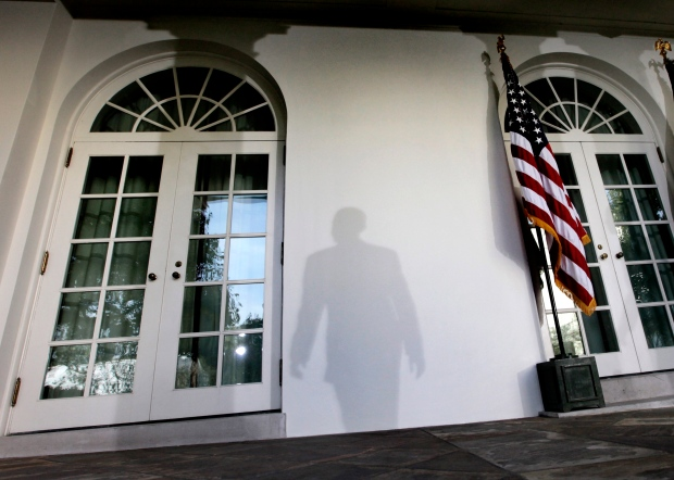 Barack Obama's shadow cast on Rose Garden wall