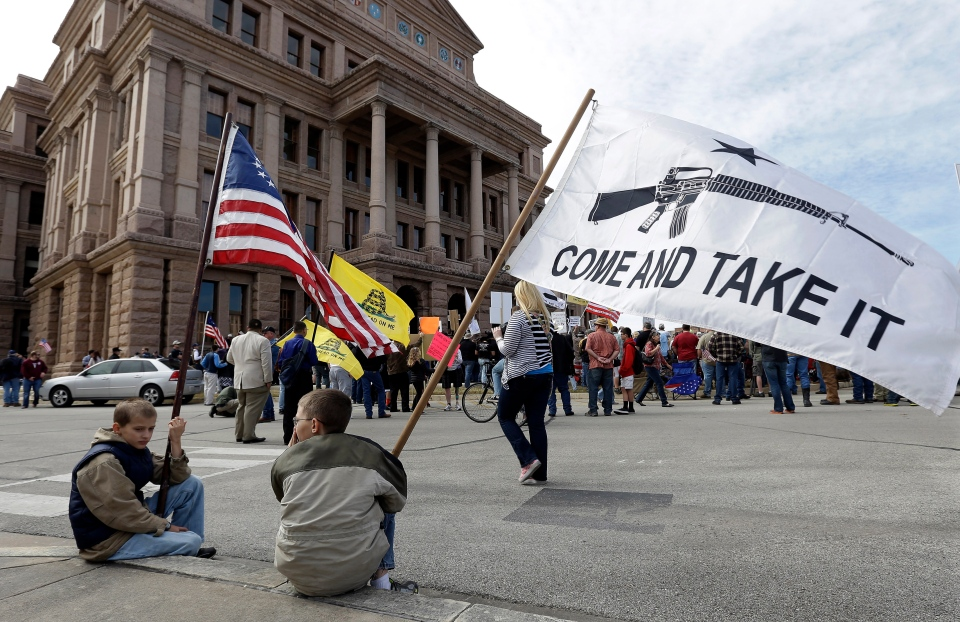Gun rights supporters gather at a Guns Across America rally at the Texas state capitol, Saturday, Jan. 19, 2013, in Austin, Texas. (AP Photo/Eric Gay)