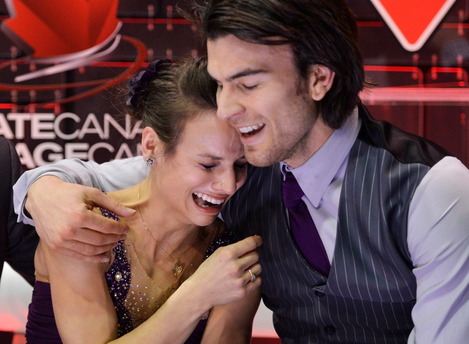 Meagan Duhamel and Eric Radford react after winning the senior pair free skate program during the 2013 Canadian Figure Skating Championships in Mississauga, Ont., on Saturday, January 19, 2013. (Nathan Denette / THE CANADIAN PRESS)