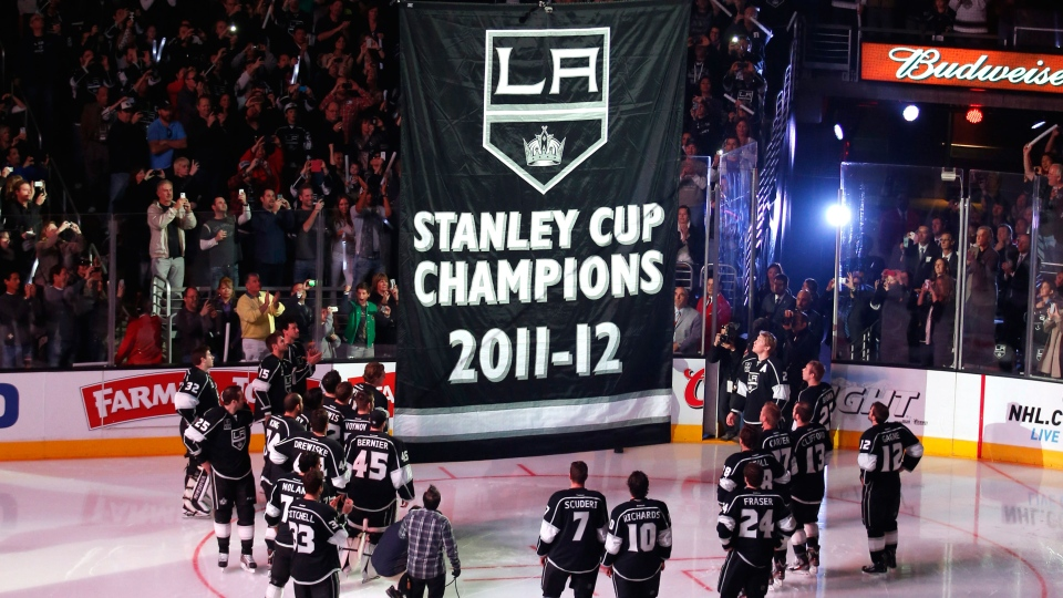 The Los Angeles Kings watch as the Stanley Cup championship banner is raised before the Kings' NHL hockey game against the Chicago Blackhawks in Los Angeles, Saturday, Jan. 19, 2013. (AP / Jae C. Hong)