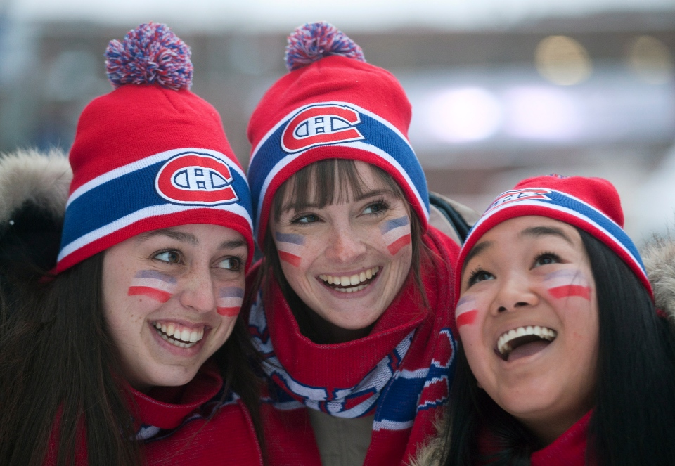 Montreal Canadiens' fans cheer outside the Bell Centre in Montreal Saturday, January 19, 2013 ahead of the Canadiens' NHL home opener against the Toronto Maple Leafs. THE CANADIAN PRESS/Graham Hughes.