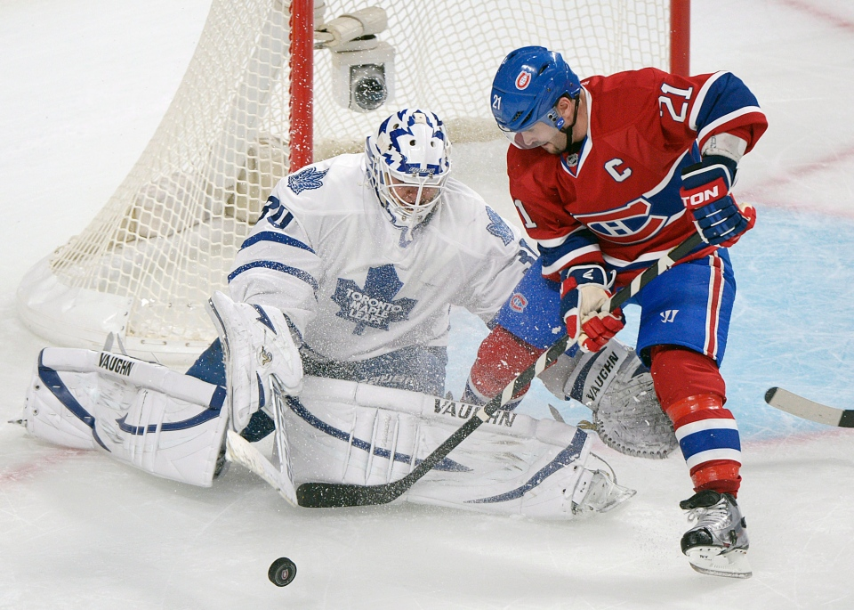 Toronto Maple Leafs' goaltender Ben Scrivens makes a save against Montreal Canadiens' Brian Gionta (21) during first period NHL hockey action in Montreal, Saturday, January 19, 2013. THE CANADIAN PRESS/Graham Hughes