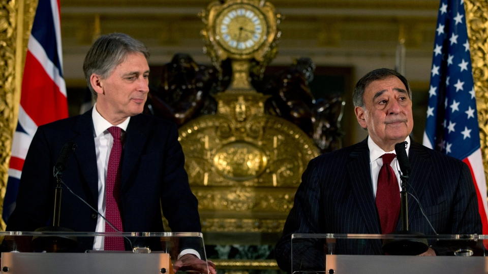 Britain's Secretary of State for Defense Philip Hammond, left, speak to the media with U.S. Defense Secretary Leon Panetta during a news conference at Lancaster House in London on Saturday, Jan. 19, 2013. (AP / Jacquelyn Martin)