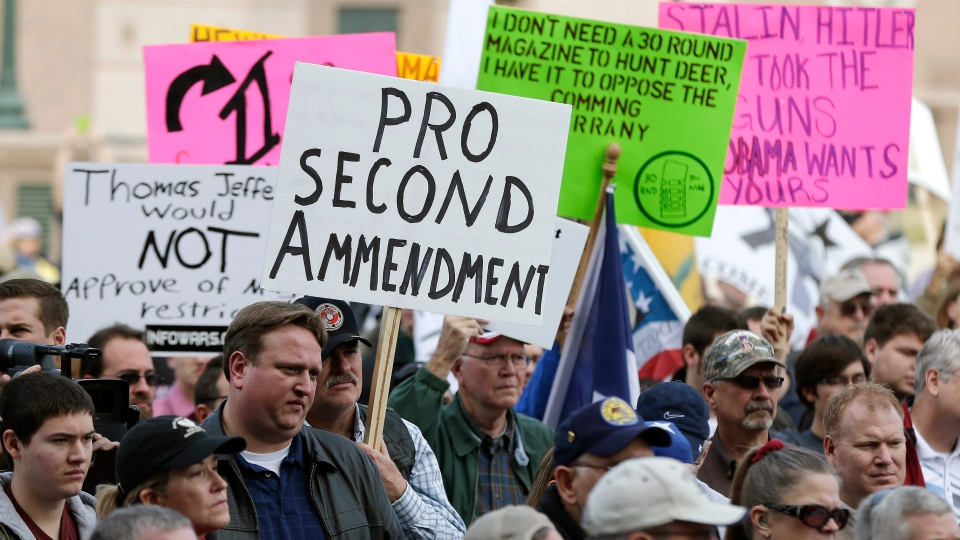 Gun rights supporters hold signs at a Guns Across America rally at the Texas state capitol, Saturday, Jan. 19, 2013, in Austin, Texas. (AP Photo / Eric Gay)
