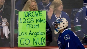 Vancouver Canucks' goalie Roberto Luongo skates past a fan holding up a sign during the pre-game skate before playing the Anaheim Ducks in their NHL hockey season opener in Vancouver on Saturday, January 19, 2013. (Darryl Dyck / THE CANADIAN PRESS)