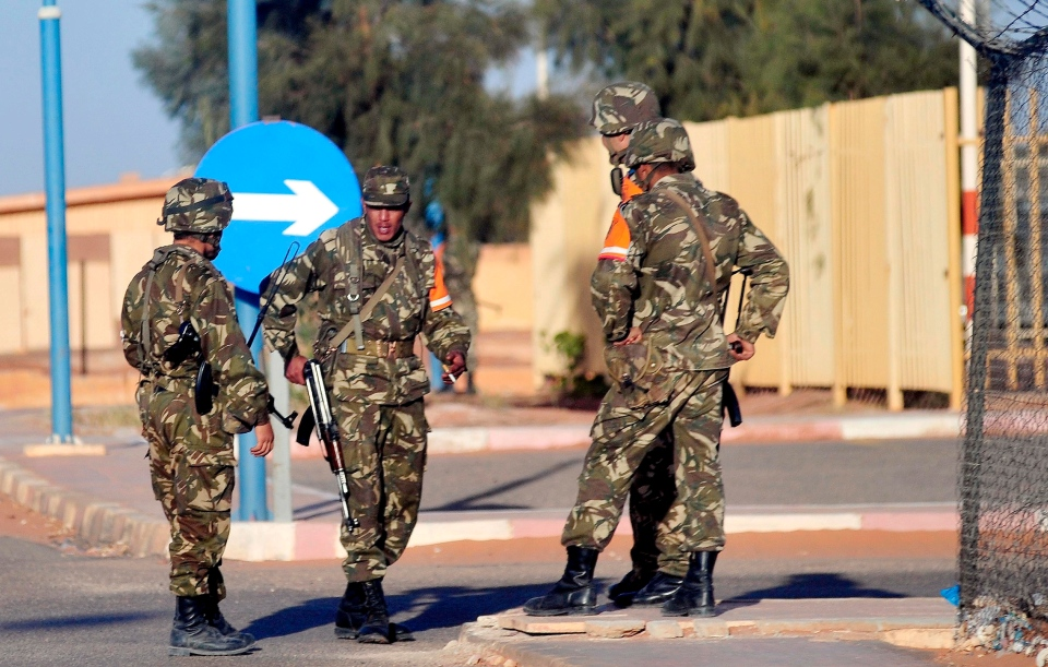 In this photo released by China's Xinhua News Agency, Algerian soldiers secure the airport in Ain Amenas, Algeria, before the departure of freed hostages Saturday, Jan. 19, 2013. (AP / Xinhua, Mohamed Kadri)