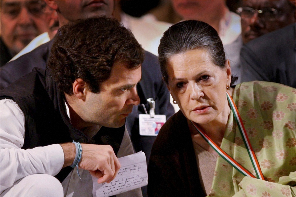 India's Congress party leader Rahul Gandhi, left, talks to his mother and party president Sonia Gandhi at a meeting of the party in Jaipur, India, Sunday, Jan. 20, 2013. (AP Photo)