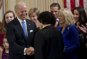 Vice President Joe Biden shakes hands with US Supreme Court Justice Sonia Sotomayor after taking the oath of office during the 57th Presidential Inauguration official swearing-in ceremony at the Naval Observatory on Sunday, January 20, 2013 in Washington. (AP / Saul Loeb)