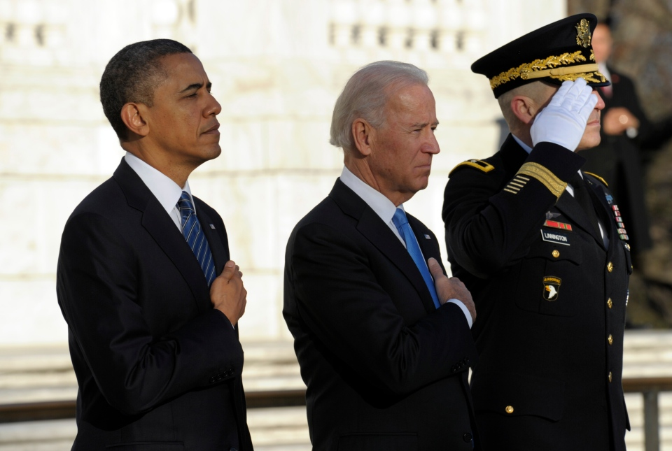 President Barack Obama and Vice President Joe Biden, accompanied by Maj. Gen. Michael S. Linnington, Commander of the U.S. Army Military District of Washington, listen to Taps after placing a wreath at the Tomb of the Unknowns at Arlington National Cemetery in Arlington, Va., Sunday, Jan. 20, 2013. (AP / Susan Walsh)