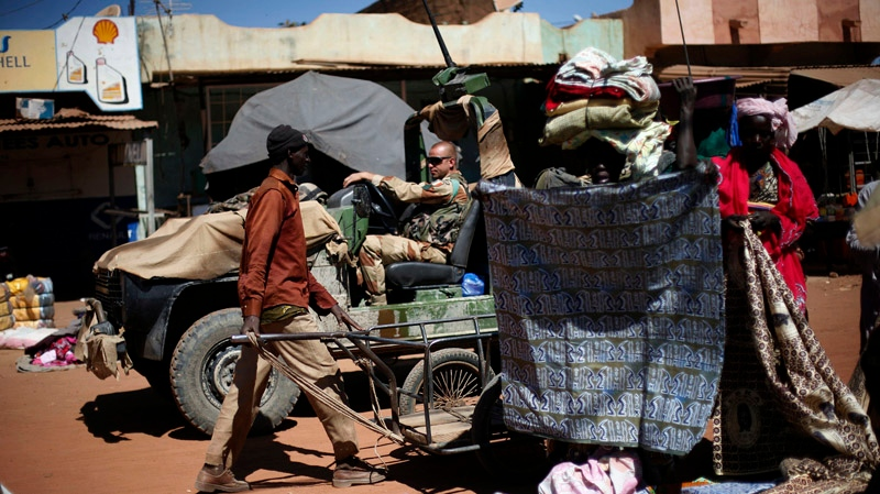 French foreign legionnaires drive through the market in Niono, some 400 kilometres north of the capital Bamako, Sunday, Jan. 20, 2013. (AP  / Jerome Delay)