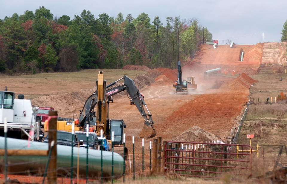 Crews work on construction of the TransCanada Keystone XL Pipeline near County Road 363 and County Road 357, east of Winona, Texas, Monday, Dec. 3, 2012. (The Tyler Morning Telegraph, Sarah A. Miller)