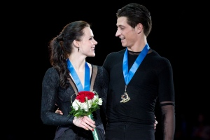 Tessa Virtue and Scott Moir celebrate their gold medals after winning the Free Dance Program at the Canadian Tire National Figure Skating Championships in Mississauga, Ont. on Sunday January 20, 2013. (Chris Young / THE CANADIAN PRESS)