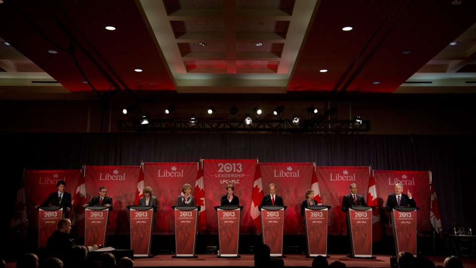 Federal Liberal Leadership candidate Marc Garneau responds to a question as the other candidates look on during the Federal Liberal debate in Vancouver, B.C., Sunday, January 20, 2013. (Jonathan Hayward / THE CANADIAN PRESS)