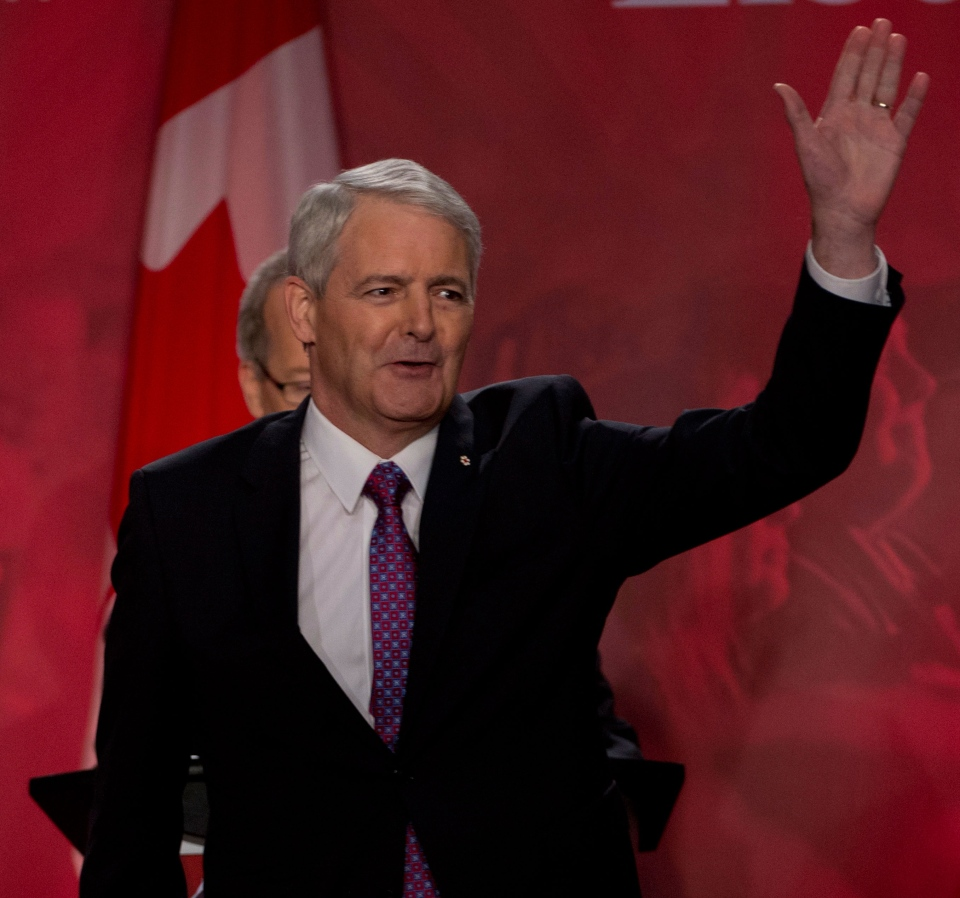 Federal Liberal Leadership candidate Marc Garneau waves to the crowd prior to the start of the Federal Liberal debate in Vancouver, B.C., Sunday, January, 20, 2013. (Jonathan Hayward / THE CANADIAN PRESS)