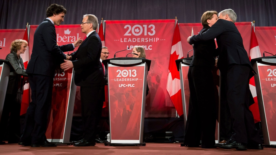 Federal Liberal leadership candidates Justin Trudeau, second left, and George Takach, shake hands as Marc Garneau, right, and Martha Hall Findlay embrace after the party's first leadership debate in Vancouver, B.C., on Sunday January 20, 2013. (Darryl Dyck / THE CANADIAN PRESS)