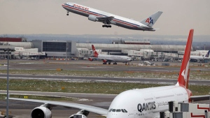 Planes are seen at Heathrow Airport in London, Thursday, Dec. 23, 2010. (AP / Kirsty Wigglesworth)