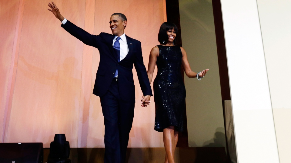 President Barack Obama and first lady Michelle Obama arrive to speak to supporters and donors at an inaugural reception for the 57th Presidential Inauguration at The National Building Museum in Washington, Sunday, Jan. 20, 2013. (AP / Charles Dharapak)