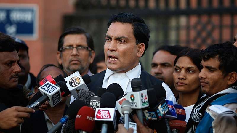 A.P Singh, lawyer for one of the accused, speaks to journalists outside the Saket district court complex where the five men facing charges of rape and murder of a 23-year-old woman aboard a moving bus in the capital last month stand trial, in New Delhi, India, Monday, Jan. 21, 2013. (AP / Saurabh Das)