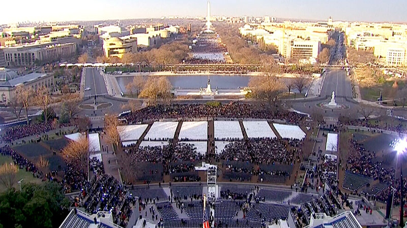 People begin to gather at the National Mall to witness the inauguration of U.S. President Barack Obama in Washington, Monday, Jan. 21, 2013.