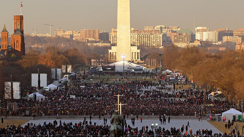 The crowd starts to fill up the National Mall early in the morning before the ceremonial swearing-in of President Barack Obama at the U.S. Capitol during the 57th Presidential Inauguration in Washington, Monday, Jan. 21, 2013. (AP / Pablo Martinez Monsivais)