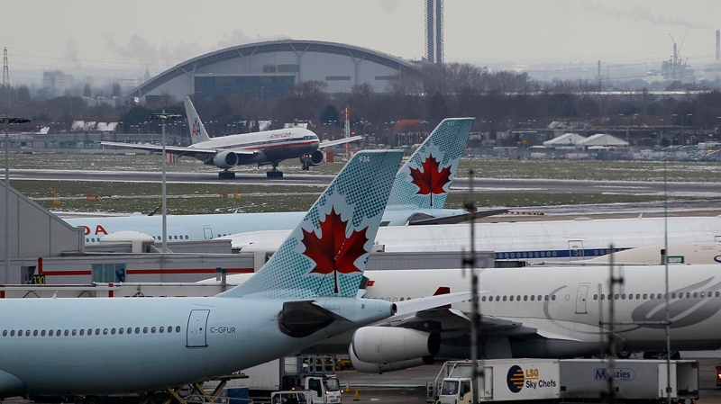Air Canada planes at Heathrow Airport in London, on Dec. 23, 2010. (AP / Kirsty Wigglesworth)
