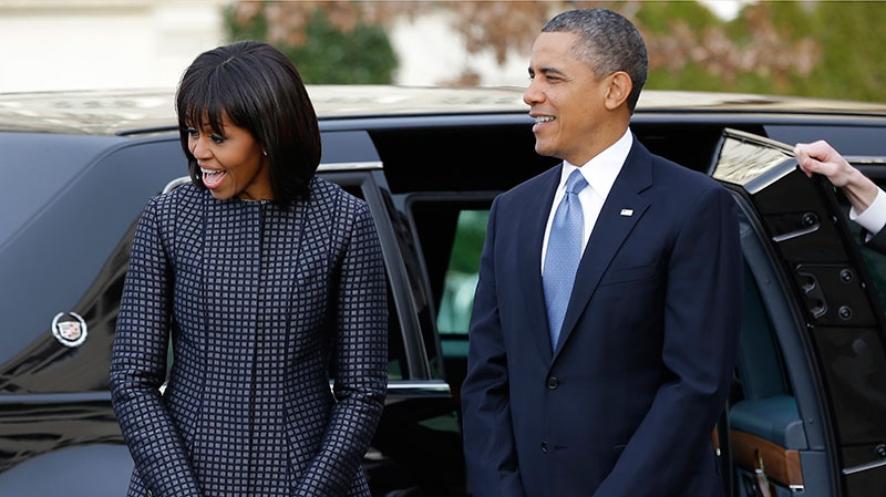 President Barack Obama and first lady Michelle Obama react as they watch their daughters as the first family arrives at St. John's Church for a church service during the 57th Presidential Inauguration, Washington, Monday, Jan. 21, 2013. (AP / Jacquelyn Martin)