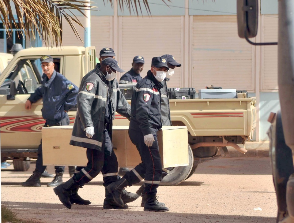 Algerian firemen carry a coffin containing a person killed during the gas facility hostage situation at the morgue in Ain Amenas, Algeria, Monday, Jan. 21, 2013. (AP / Anis Belghoul)