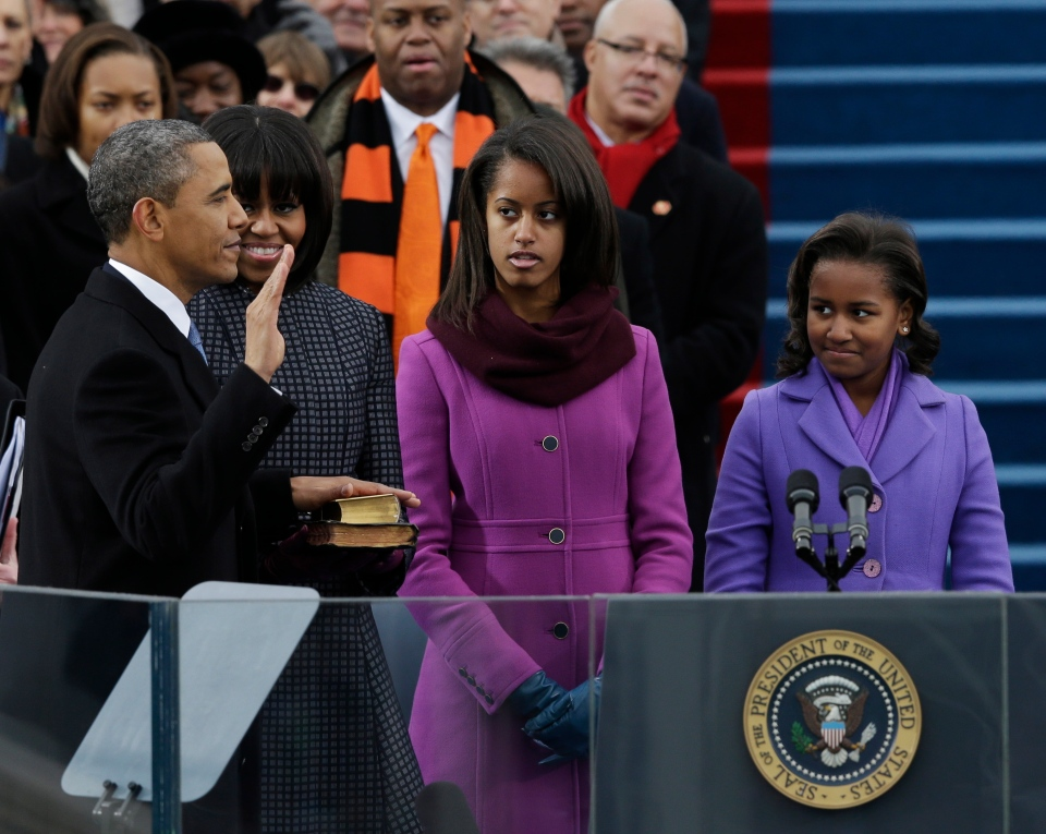 U.S. President Barack Obama's family watches during the ceremonial swearing-in at the U.S. Capitol during the 57th Presidential Inauguration in Washington, Monday, Jan. 21, 2013. (AP / Pablo Martinez Monsivais)