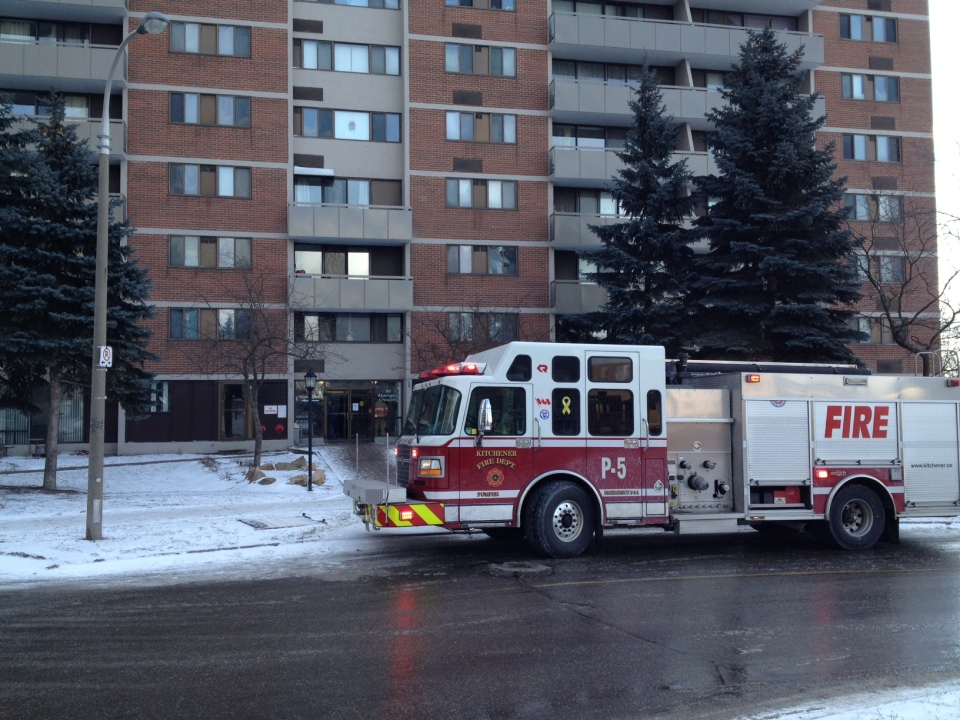 Firefighters are seen at the scene of an apartment fire on Mooregate Crescent in Kitchener, Ont., on Monday, Jan. 21, 2013. (David Imrie / CTV Kitchener)