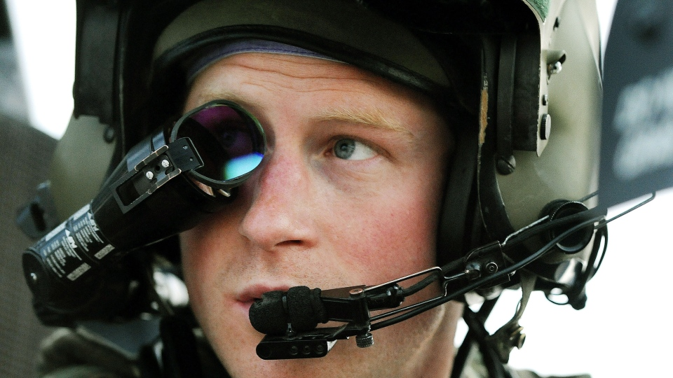 Britain's Prince Harry wears his monocle gun sight as he sits in the front seat of his cockpit at the British controlled flight-line in Camp Bastion southern Afghanistan in this December 2012 file photo. (AP Photo/John Stillwell)