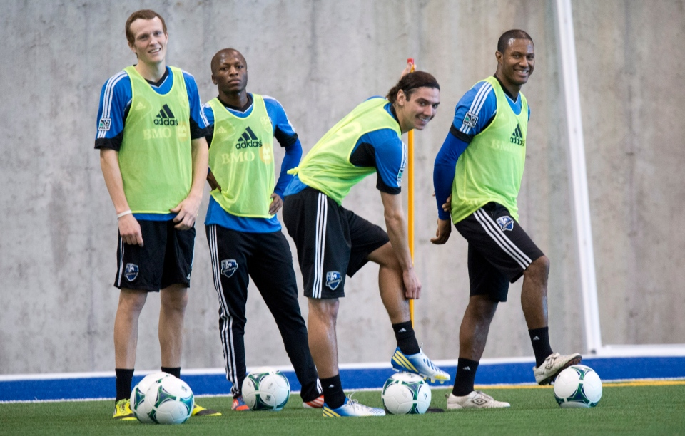 Montreal Impact Wandrille Lefevre, Sanna Nyassi, Zarek Valentin and Patrice Bernier, left to right, take a break during the first day of training camp Montreal, Monday, January 21, 2013 i. THE CANADIAN PRESS/Paul Chiasson