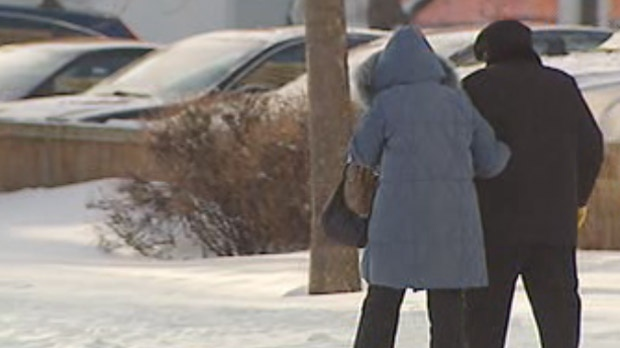 Residents brave the frigid temperatures in Winnipeg on Jan. 21, 2013.
