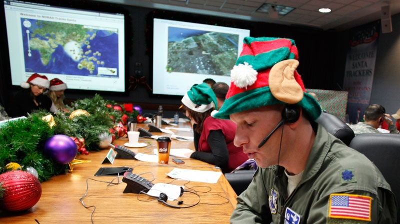 Air Force Lt. Col. David Hanson, of Chicago, takes a phone call from a youngster in Florida at the Santa Tracking Operations Center at Peterson Air Force Base near Colorado Springs, Colo., on Friday, Dec. 24, 2010. (AP / Ed Andrieski)