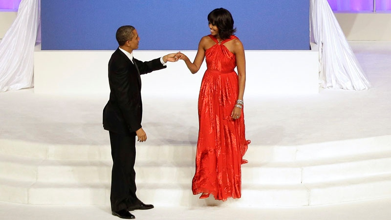 U.S. President Barack Obama greets first lady Michelle Obama as she arrives on stage during the Commander-In-Chief inaugural ball at the Washington Convention Center during the 57th Presidential Inauguration Monday, Jan. 21, 2013, in Washington. (AP / Evan Vucci)