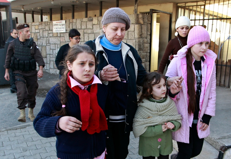 Russian family walk together shortly after crossing the border from Syria into Lebanon at the Masnaa border crossing in eastern Lebanon, Tuesday, Jan. 22, 2013. (AP / Bilal Hussein)