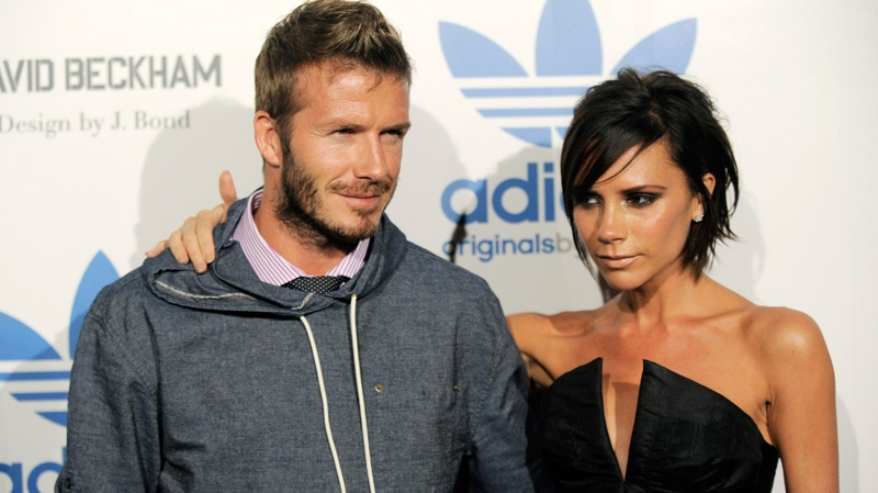 David Beckham and his wife Victoria arrive at an event to celebrate the launch of the Adidas Originals by Originals David Beckham clothing line designed by James Bond, Wednesday, Sept. 30, 2009, in Los Angeles. (AP / Chris Pizzello)