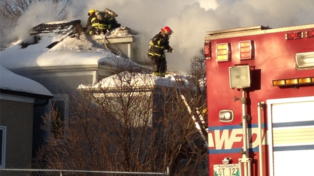 Crews battle the fire on Trent Avenue in Winnipeg on Jan. 22, 2013.