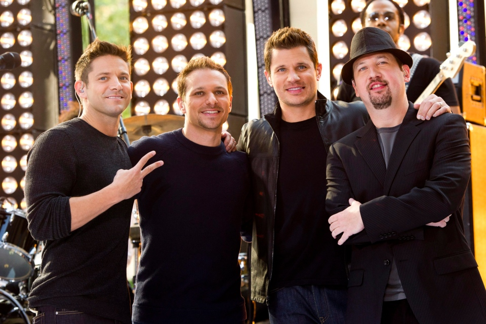 "Members of 98 Degrees, from left to right, Jeff Timmons, Drew Lachey, Nick Lachey and Justin Jeffre appear on NBC's ""Today"" show, Friday, Aug. 17, 2012, in New York. (Charles Sykes/Invision/AP)"