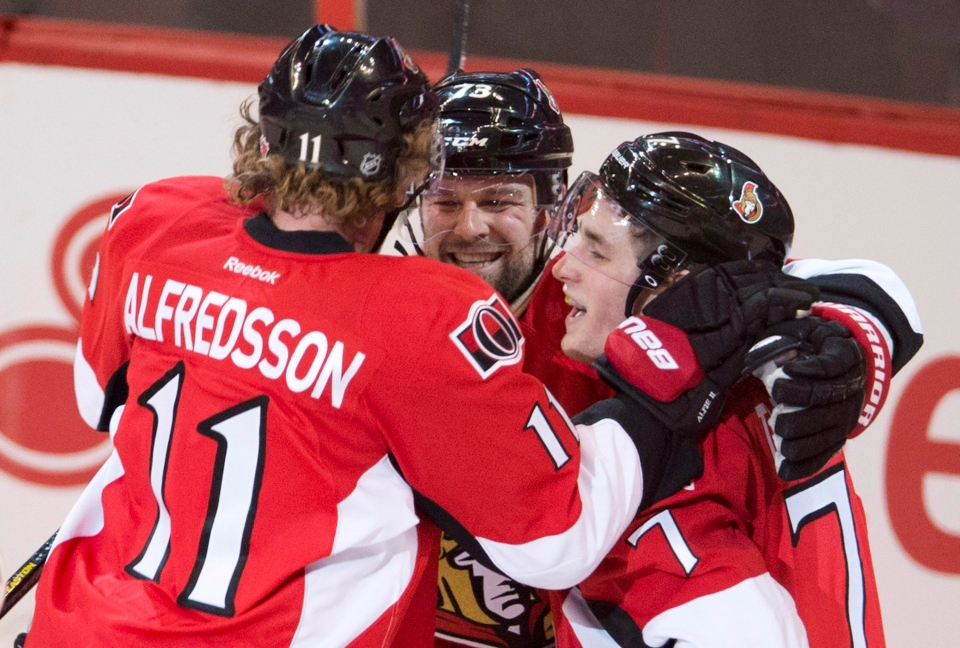 Ottawa Senators center Kyle Turris(right) is congratulated by teammates right wing Daniel Alfredsson and Guillaume Latendresse following a goal during second period NHL action against the Florida Panthers in Ottawa, Monday January 21, 2013. (THE CANADIAN PRESS/Adrian Wyld)